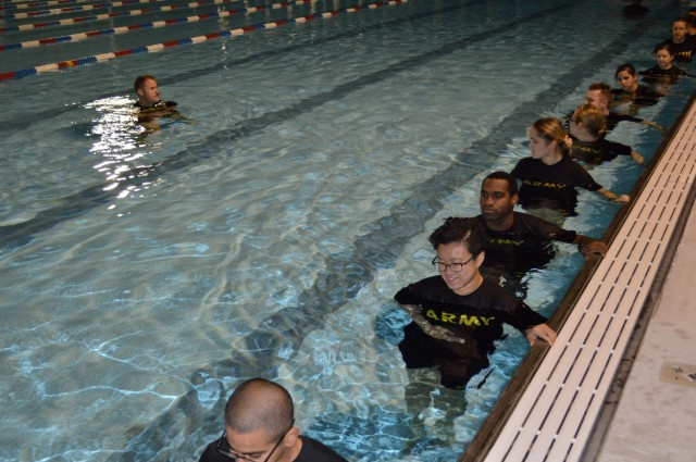 Army Staff Sgt. Timothy S. McCoole, a Drill Sergeant with the Gladiator program at Joint Base San Antonio Fort Sam Houston, leads a group of Soldier medics in training through morning exercises at the Fort Sam Houston aquatic center. The Gladiator program, which was initiated by the Soldiers in Training Physical Therapy Clinic on JBSA Fort Sam Houston, is designed to improve the physical readiness of Soldier medics throughout their training by identifying those who sustained an injury in Basic Training and providing additional therapy and support for them while they are in their advanced training.  (U.S. Army photo by Daniel J. Calderón)