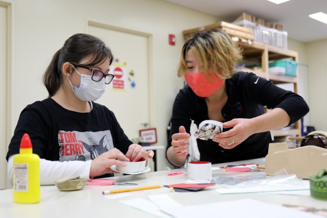 Saori Komura, right, an art instructor for the Camp Zama Arts and Crafts Center, helps Camryn Rosa, 11, make a washi paper box at Camp Zama, Japan, Jan. 23.