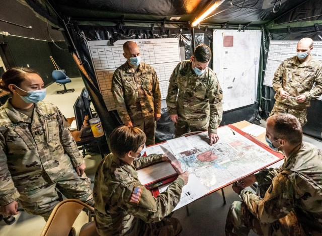 Basic Officer Leader Course students collaborate before conducting a fire direction simulator