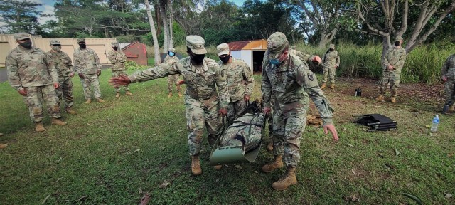 Multi-component Soldiers from 311th Signal Command (Theater) attempt to transport a simulated litter patient during the command's Battle Assembly, Jan. 23-24, 2021 at Schofield Barracks on Oahu, Hawaii. The event was conducted to train Soldiers on Army Warrior Tasks. Soldiers learned litter-carrying procedures and how to apply medical first aid to head, open chest and abdominal wounds (Official U.S. Army photo by Marc Ayalin).