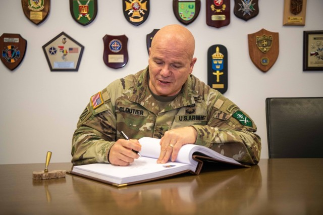SZCZECIN, Poland (January 22, 2021) – Allied Land Command Commander, U.S. Army Lt. Gen. Roger Cloutier, signs the guest book at Baltic Barracks, headquarters for Multinational Corps Northeast. Izmir, Turkey-based LANDCOM will conduct a CREVAL of MNC-NE later this year to certify the Szczecin, Poland-based NATO Corps as NATO's Warfighting Corps for 2022.  (NATO photo courtesy of MNC-NE Public Affairs)