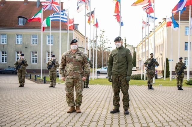 SZCZECIN, Poland (January 22, 2021) – Allied Land Command Commander, U.S. Army Lt. Gen. Roger Cloutier (left) and Multinational Corps Northeast Commander, Polish Army Lieutenant General Sławomir Wojciechowski, take part in the official arrival ceremony to kick off Combat Readiness Evaluation (CREVAL) discussions between the two NATO land domain organisations. Izmir, Turkey-based LANDCOM will conduct a CREVAL of MNC-NE later this year to certify the Szczecin, Poland-based NATO Corps as NATO's Warfighting Corps for 2022.  (NATO photo courtesy of MNC-NE Public Affairs)