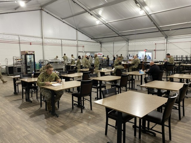 The temporary dining facility consists of a tent and three trailers which house all equipment required to prepare and serve meals. The only notable change of service at the temporary dining facility is the exclusion of an omelet bar, which did not meet fire suppression requirements. All other services offered by the temporary dining facility will remain the same.