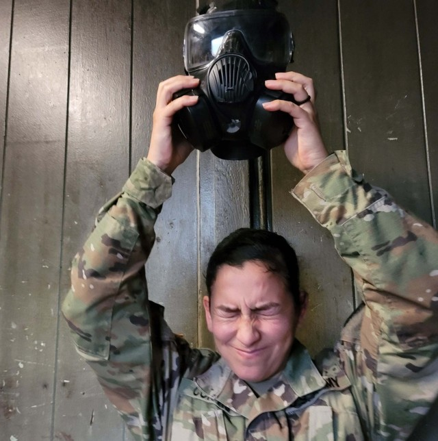 Army Staff Sgt. Virginia M. Curtis, Executive Administrative Assistant to the Command Sergeant Major, 311th Signal Command (Theater), conducts a mask confidence exercise during a Battle Assembly, Jan. 23-24, 2021, to train Soldiers on Army Warrior Tasks at Schofield Barracks on Oahu, Hawaii (Official U.S. Army photo by Warrant Officer Alyson Tugaoen).
