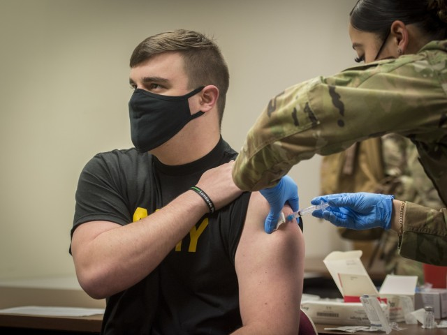 U.S. Army 1st Lt. Tucker Salls, 143rd Military Police Company, receives the Moderna COVID-19 vaccine at Bradley Air National Guard Base in East Granby, Connecticut, Jan. 2, 2021. The Connecticut National Guard began administering the vaccine in accordance with the Department of Defense COVID-19 Vaccine Distribution Plan, with doses voluntarily administered to Soldiers and Airmen on the front lines of the COVID-19 pandemic response. (U.S. Air National Guard photo by Staff Sgt. Steven Tucker)