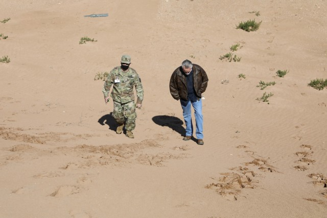 Master Sgt. Joshua Heaton, Georgia Army National Guard, and Scott McWhorter, Southern European Task Force, Africa, survey a small arms firing range in Morocco Jan. 20, 2021. Heaton and McWhorter joined two dozen U.S. military planners in Morocco to establish plans for the African Lion 21 exercise, scheduled for June. African Lion, U.S. Africa Command's largest exercise, has increased interoperability among U.S. partners and Allies since 2003. Plans for AL21 involve more than 10,000 troops from the United States, Morocco, Tunisia, Senegal and elsewhere. The global COVID-19 pandemic curtailed the previous year's exercise. Plans for AL21 include COVID-19 mitigations and flexible options to ensure maximum participation and value for participating countries. (U.S. Army photo by Maj. Cain S. Claxton/Southern European Task Force, Africa)