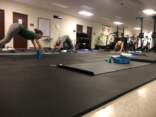 Soldiers assigned to the Fort Bragg Soldier Recovery Unit, N.C., attended a new yoga class at the adaptive reconditioning program gym on Dec. 4, 2020. (U.S. Army photo courtesy Dean Bissey)