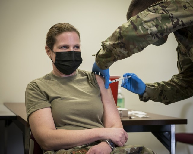 U.S. Air Force Capt. Sarah Gwinn, 103rd Medical Group chief of nursing services and Connecticut National Guard COVID-19 vaccine coordinator, receives the Moderna COVID-19 vaccine at Bradley Air National Guard Base in East Granby, Connecticut, Dec. 30, 2020. The Connecticut National Guard began administering the vaccine in accordance with the Department of Defense COVID-19 Vaccine Distribution Plan, with doses voluntarily administered to Soldiers and Airmen on the front lines of the COVID-19 pandemic response. (U.S. Air National Guard photo by Staff Sgt. Steven Tucker)