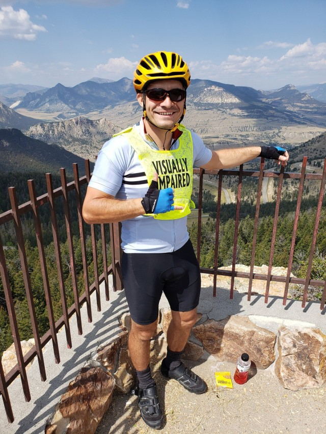 Staff Sgt. Mike Murphy poses in front of the landscape where he rode as part of the Beartooth Challenge. (Photo via Marc Cattapan)