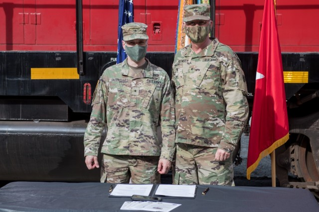 From left, U.S. Army Brigadier General Stephen Iacovelli, 94th Training Division (Force Sustainment) commander, and Brigadier General Stephen Rutner, commander of Deployment Support Command, pose for a photo after signing the Memorandum of Agreement at Joint Base Langley-Eustis, Virginia, Nov. 6, 2020. The two commanders signed an MOA that provides more career broadening opportunities for the Soldiers of the 757th Transportation Battalion. (U.S. Air Force photo by Senior Airman Derek Seifert)