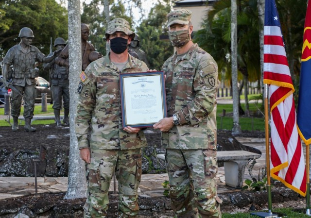"""Col. Joshua Gaspard, left, G3 operations officer, 25th Infantry Division, poses with Maj. Gen. James Jarrard, commanding general, 25th Inf. Div. and U.S. Army Hawaii, after receiving his promotion to colonel on Schofield Barracks, Hawaii, in Nov. 13, 2020. Gaspard is one of the first officers in the U.S. Army to get a brevet promotion in over 100 years. """"General Jarrard gets a huge say in my career progression, but really, the next step for me will be the Senior Service College, I got a chance to be on the list for that so I can hold the L3 position for another year,"""" said Gaspard."""