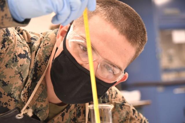 Marine Corps Lance Cpl. Kirkland D. Cochran observes fuel temperature while conducting American Petroleum Institute testing Jan. 22 at the Lab Training Division, Quartermaster School.