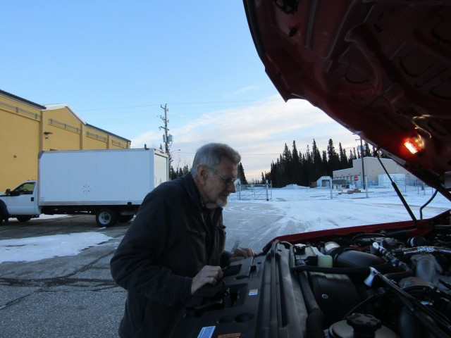 Rob Gibbens checks over a new truck assigned to the fire department at Fort Greely.