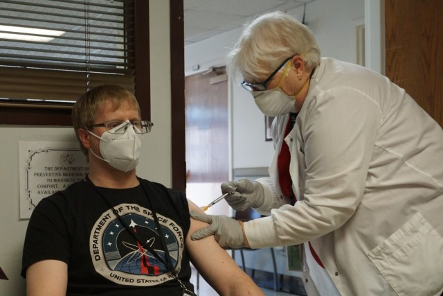 Nurse giving man shot