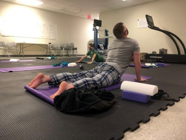 On Dec. 4, 2020, Soldiers assigned to the Fort Bragg Soldier Recovery Unit, N.C, took a new yoga class at the adaptive reconditioning program gym. (U.S. Army photo courtesy Dean Bissey)