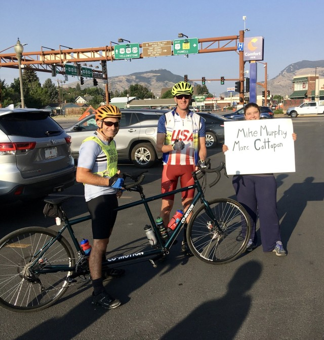 Staff Sgt. Mike Murphy (left) and Marc Cattapan (center) show off their tandem bike they used to ride in the Beartooth Challenge. (Photo via Marc Cattapan)