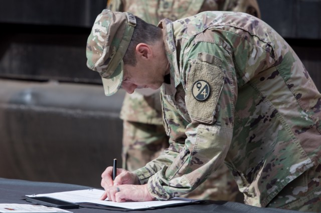 U.S. Army Brigadier General Stephen Iacovelli, 94th Training Division (Force Sustainment) commander, signs the Memorandum of Agreement at Joint Base Langley-Eustis, Virginia, Nov. 6, 2020. The MOA allows Soldiers from the 757th Transportation Battalion to attend the Basic Instructor Course and return to their unit as an instructor and conduct annual training. (U.S. Air Force photo by Senior Airman Derek Seifert)