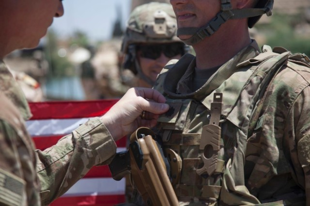 A U.S. Army Soldier is promoted to the rank of Lt. Col.