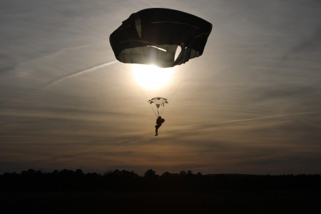 A U.S. Army paratrooper navigates Sicily Drop Zone to a safe landing at Fort Bragg, N.C., Dec. 3, 2020, during non-tactical airborne operations hosted by the U.S. Army Reserve's U.S. Army Civil Affairs and Psychological Operations Command (Airborne) and the 82nd Airborne Division.