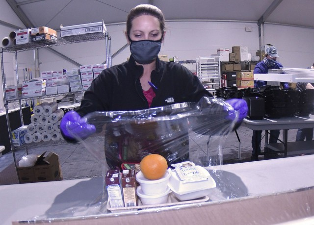 Contract employee Tabitha Gore wraps a meal in cellophane at the Fort Lee Logistics Support Area dining facility Jan. 13. Its patrons have the option of choosing takeout meals or eating in the 120-person capacity dining area.