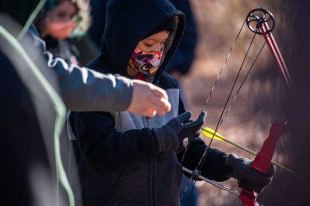William Sexton, 10, learns how to pull back the bowstring during Beginners' Archery, Jan 23.