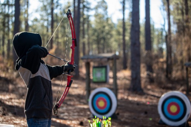 William Sexton, 10, aims at a target during Beginners' Archery, Jan 23.