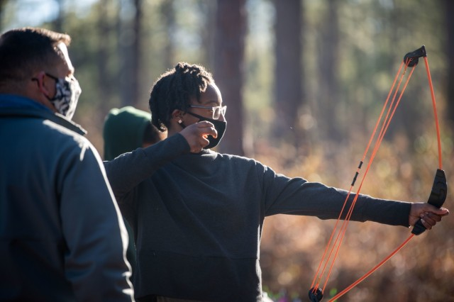 Kaziyah Boone-Spruill, 13, shoots at a target during Beginners' Archery, Jan 23.