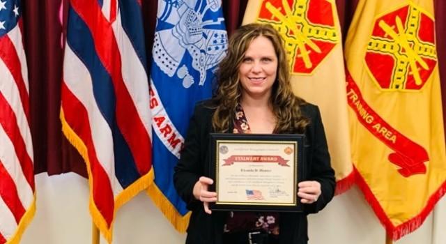Rhonda Hunter receives the Installation Management Command Stalwart Award Jan. 28.