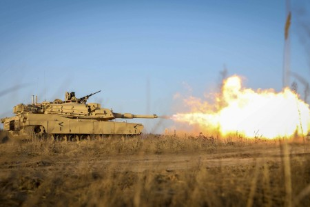 An Army M1 Abrams tank fires during live-fire training at Pabrade Training Area, Lithuania, Dec. 10, 2020.