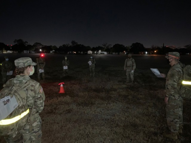 Brooke Army Medical Center Psychology and Social Work interns and residents participate in a pre-dawn 2 mile memorial road march on Joint Base San Antonio-Fort Sam Houston Nov. 20, 2020. The Soldiers partnered with their counterparts from Desmond T. Doss Health Clinic, Schofield Barracks, Hawaii, to honor 13 Soldiers who were killed in action during wartime operations. (courtesy photo)
