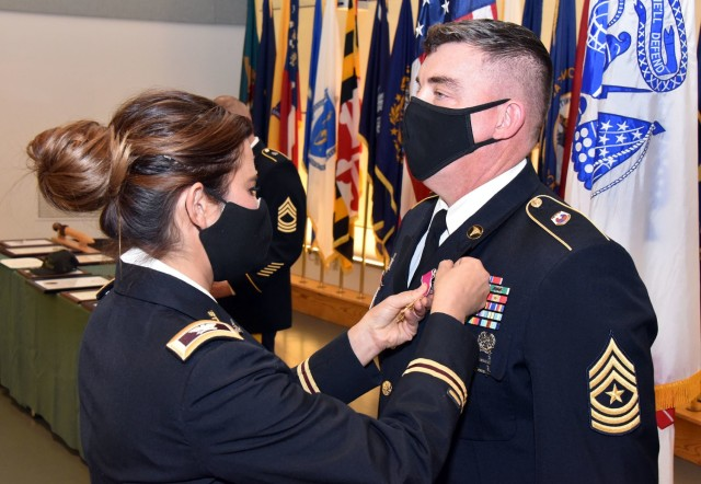 Col. Lynn Marm, left, pins the Legion of Merit medal on to Sgt. Maj. Corey A. Lord, whose 30-year career was recognized during a retirement ceremony on Jan. 29 at Fort Detrick, Maryland.