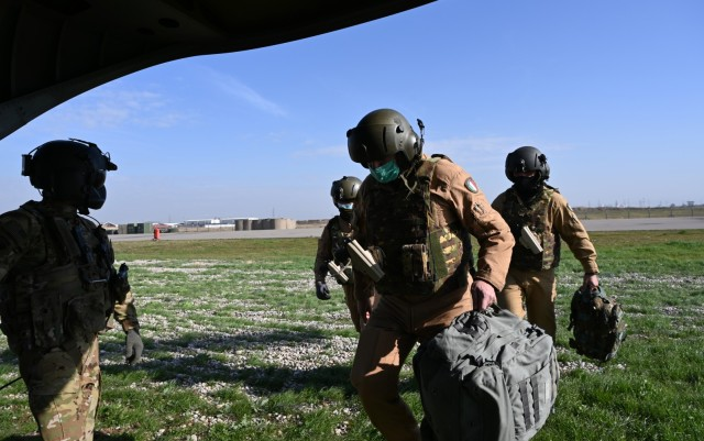 U.S. Soldiers with Task Force Gambler and Italian soldiers with Airmobile Task Group Griffon respond to a downed aircraft scenario during an aerial reaction force exercise in Iraq. The exercise ensured the coalition partners' cohesiveness in responding to downed aircraft emergencies in hostile environments. (U.S. Army photo by 1st Lt. Alysa Nantarojanaporn)
