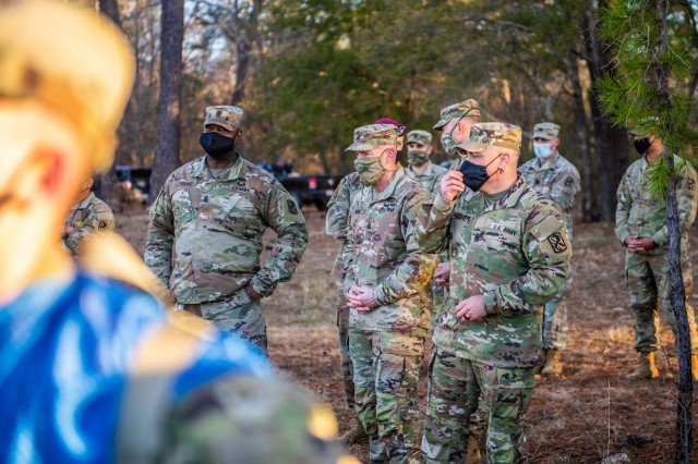 FORT BENNING, Ga. – Command Sgts. Maj. Todd Sims and T.J. Holland, the senior enlisted Soldier for Forces Command and 18th Airborne Corps, respectively, visited Sand Hill, the home of Infantry one-station unit training, to see the First 100 Yards, Jan. 29, 2021. (U.S. Army photo by Patrick A. Albright, Fort Benning Maneuver Center of Excellence photographer)