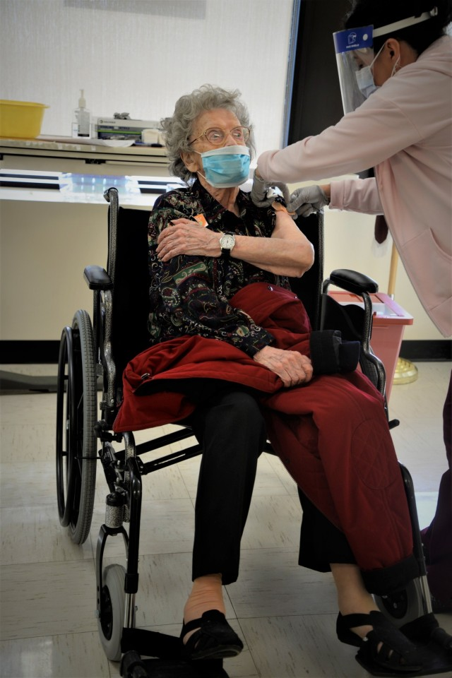 FORT LEONARD WOOD, Mo. – Wilma Tucker, 99, received her Covid-19 vaccination at General Leonard Wood Army Community Hospital Jan. 29. Tucker was a WWII veteran and stenographer for U.S. Forces Headquarters in Austria. (U.S. Army photo by Chad Ashe, GLWACH Public Affairs)
