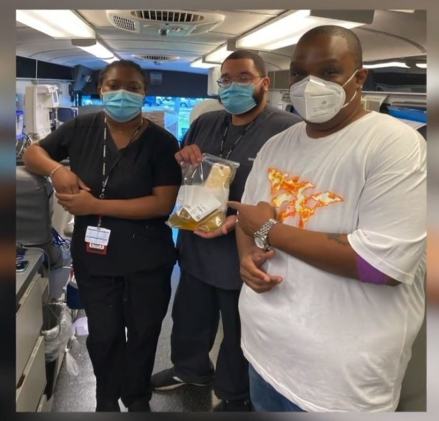 Orlando Davis, radio personality at WiLD 94.1 radio station, gathers for a photo with OneBlood team members in Tampa, Florida, after making a plasma donation in November. (Photo courtesy of Maj. Katherine Williams, ASC).
