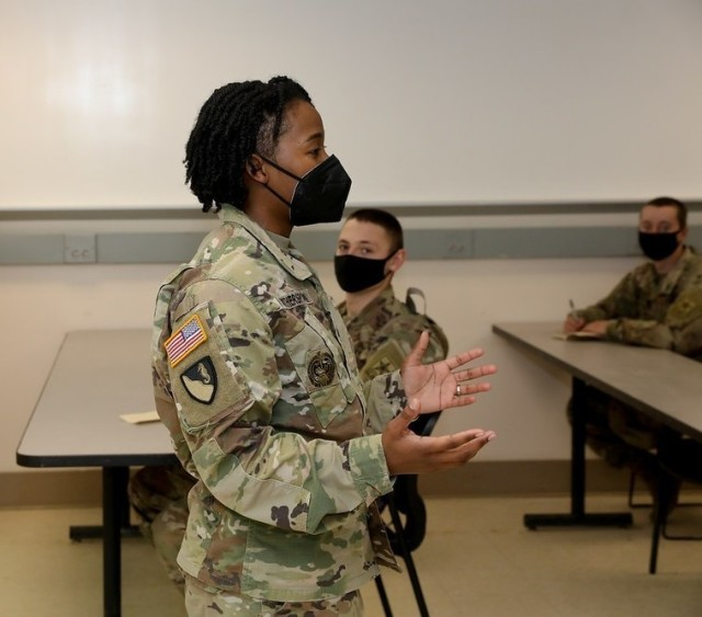 FORT BENNING, Ga. – Staff Sgt. Tamarisk Witherspoon offers tips to trainees here Feb. 3 during a briefing she designed to help Soldiers get off to a good start once they graduate training and move to their new duty stations. Witherspoon, a drill sergeant with Alpha Company, 1st Battalion, 81st Armor Regiment, 194th Armored Brigade, designed the briefing about two years ago. In it she encourages trainees to maintain a bank account and save money, to further their education, and to avoid errors like rushing to buy a car without first checking the reputation of the dealership, and offers other practical advice and information about settling in at a new unit.(U.S. Army photo by Markeith Horace, Maneuver Center of Excellence and Fort Benning Public Affairs)