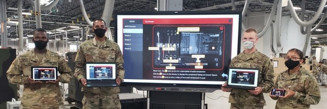 Students in the 91D Tactical Power Generation Specialist Course display interactive multimedia instruction (IMI) capabilities on a tablet, two laptops, a cell phone, and a Smart TV.