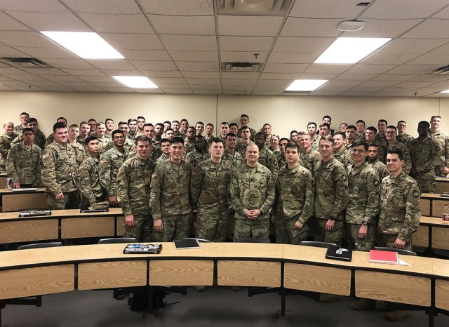 Command Sgt. Maj. Sam Crislip poses with West Point cadets he taught during the Information Technology course, focusing on cyber policy, strategy and operations. He used his knowledge and experience to illustrate how cyber was applicable to their Army career.   (Courtesy Photo)