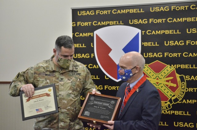 John Watson, chief of Fort Campbell's Training Division, Directorate of Plans, Training, Mobilization and Security, receives an Installation Management Command Stalwart Award from Col. Jeremy D. Bell, Fort Campbell garrison commander, during a virtual Installation Management Command awards presentation Jan. 28 at Eagle Conference Room.