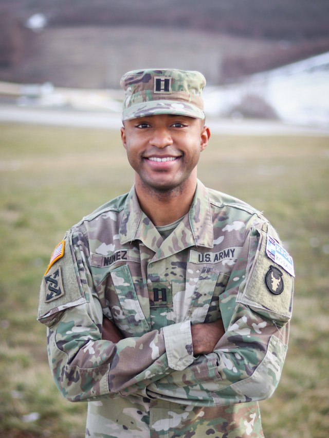 U.S. Army Reserve Capt. Cassian Nuñez, a budget program analyst with the 3rd Medical Command (Deployment Support) based out of Atlanta, Georgia, smiles for a portrait at Camp Bondsteel, Kosovo, on Jan. 22, 2021. Nuñez delivered a speech on Dr. Martin Luther King Jr. day at the base's dining facility in honor of the civil rights leader. To celebrate Black History Month while deployed, he reflected on the influence his civilian education and military career have shaped his views on race in the U.S. Nuñez said it's important to honor the sacrifice and achievements of African Americans throughout the year, not just this month. (U.S. Army National Guard photo by Staff Sgt. Tawny Schmit)