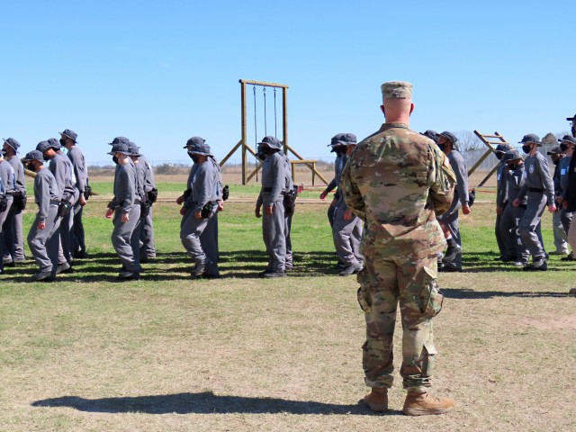 Sgt. Jason Pope inspects drill and ceremony movements during the acclimation phase at the Texas ChalleNGe Academy in Eagle Lake, Texas. The Texas National Guard Joint Counterdrug Task Force has supported the Texas ChalleNGe Academy for more than 20 years with mentorship, process improvement and training to help students succeed.