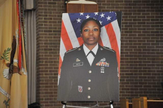 FORT LEE, Va. (Feb. 9, 2021) -- A portrait of Master Sgt. Lisa Maria Soto sits on an easel standing near the pulpit during a memorial service for the deceased Soldier at Memorial Chapel Feb. 5. Soto, assigned to Alpha Company, 244th Quartermaster Battalion, was a Soldier of 20 years. She died of complications from COVID-19.