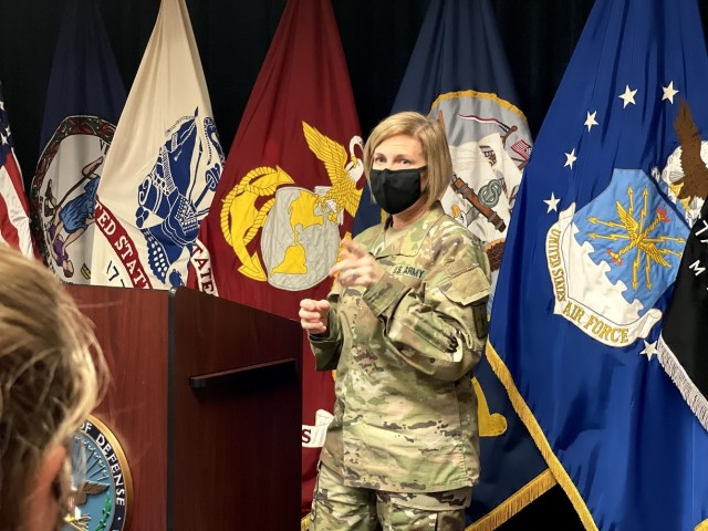Brig. Gen. Michelle M. T. Letcher addresses eight enlistees, sharing personal experiences and encouraging words prior to administering the oath of enlistment.