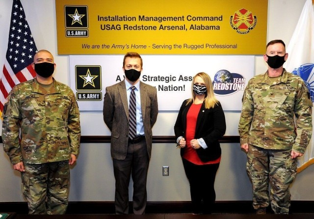 From left are Garrison Command Sgt. Maj. Juan Jimenez, Jordan Matthews, Christina Fults and Garrison Commander Col. Glenn Mellor. Matthews and Fults received the 2020 Army Installation Management Command Stalwart Awards in the IMCOM-Sustainment category.