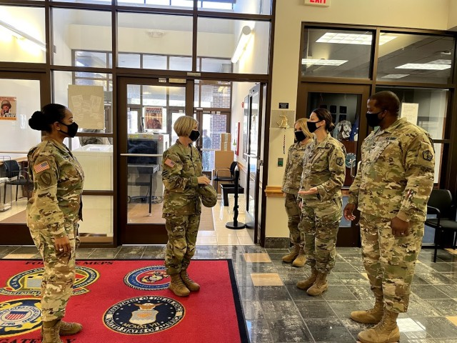 Brig. Gen, Michelle M. T. Letcher (center) and Col. Clydea Prichard-Brown (left) thank MEPS staff members for their dedication to the mission.