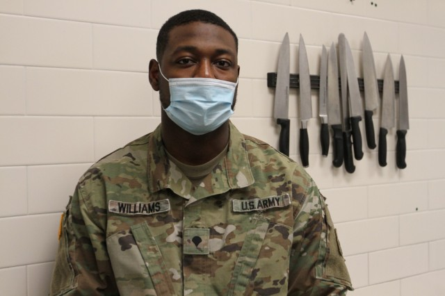 """U.S. Army Spc. Jaquavious K. Williams, a culinary specialist assigned to the 3rd Brigade Support Battalion, 1st Armored Brigade Combat Team, 3rd Infantry Division on Fort Stewart, Georgia,is from Atlanta, where he graduated from Daniel McLaughlin Therrell High School in 2017. Williams has been interested in art since he was 10 years old. His recent artwork honoring Prisoner of War/ Missing in Action Soldiers and families was a popular centerpiece at a 3rd ID Thanksgiving meal. Williams said he joined the Army because """"I just wanted to be a part of something bigger than myself."""" (U.S. Army photo by Spc. Daniel Thompson)"""