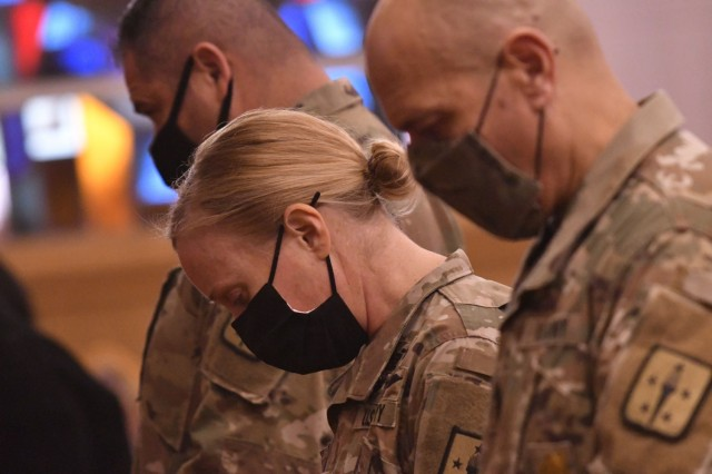 Col. Michelle K. Donahue, Quartermaster General, bows her head for the invocation during a memorial service Feb. 5 for Master Sgt. Lisa Maria Soto at Memorial Chapel. She is flanked on her right by Command Sgt. Maj. Jorge C. Escobedo, CASCOM CSM, and on her left by CSM Eric J. Vidal I, QM Corps CSM.  Soto, a 20-year Soldier who was assigned to Alpha Company, 244th Quartermaster Battalion, died from complications due to the coronavirus. She is survived by her three children, father and twin sister along with several other siblings. (Photo by T. Anthony Bell).