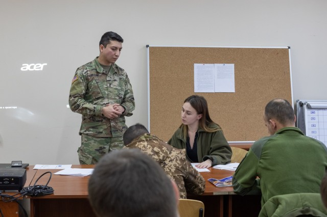 1st Lt. Johnny Vazquez teaches NATO safety standards to Armed Forces of Ukraine Soldiers during their Observer Controller Trainer academy, Feb. 3 at Combat Training Center-Yavoriv. (U.S. Army photo by Cpl. Shaylin Quaid)