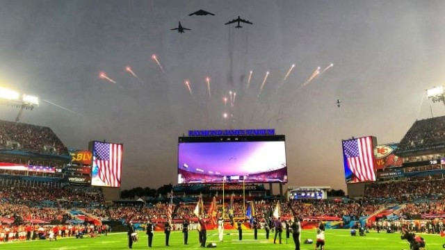 The U.S. Armed Forces Color Guard salutes as the U.S. Air Force flyover crosses the Raymond James Stadium at Super Bowl LV in Tampa, Florida, Feb. 7, 2021. The U.S. Armed Forces Color Guard is comprised of service members from the ceremonial guard units stationed in and around Washington, D.C.