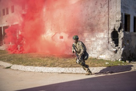 Army Sgt. Tyler Bisio reacts to simulated indirect gunfire during a competition at Fort Hood, Texas, Jan. 12, 2021.